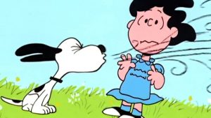 Comic image of Snoopy the dog sneezing on a girl